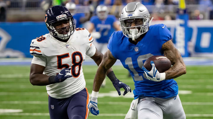 DETROIT, MI - NOVEMBER 22: Kenny Golladay #19 of the Detroit Lions runs with the football in front of Roquan Smith #58 of the Chicago Bears during an NFL, Thanksgiving Day game at Ford Field on November 22, 2018 in Detroit, Michigan. The Bears defeated the Lions 23-16. (Photo by Dave Reginek/Getty Images)