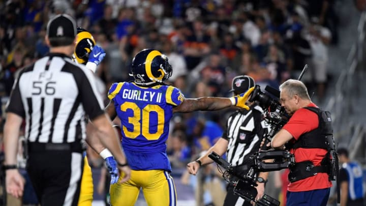 LOS ANGELES, CA - NOVEMBER 17: Todd Gurley #30 of the Los Angeles Rams celebrates his touchdown with a television cameramen against the Chicago Bears during the first half at Los Angeles Memorial Coliseum on November 17, 2019 in Los Angeles, California. (Photo by Kevork Djansezian/Getty Images)