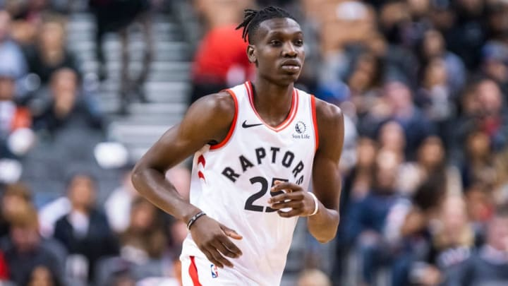 TORONTO, ONTARIO - OCTOBER 13: Chris Boucher #25 of the Toronto Raptors transitions agains the Chicago Bulls during their NBA basketball pre-season game at Scotiabank Arena on October 13, 2019 in Toronto, Canada. NOTE TO USER: User expressly acknowledges and agrees that, by downloading and or using this photograph, User is consenting to the terms and conditions of the Getty Images License Agreement. (Photo by Mark Blinch/Getty Images)