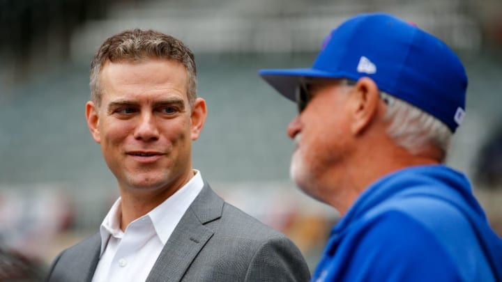ATLANTA, GA - APRIL 04: Chicago Cubs general manager Theo Epstein speaks with Manager Joe Maddon during batting practice prior to an MLB game against the Atlanta Braves at SunTrust Park on April 4, 2019 in Atlanta, Georgia. (Photo by Todd Kirkland/Getty Images)