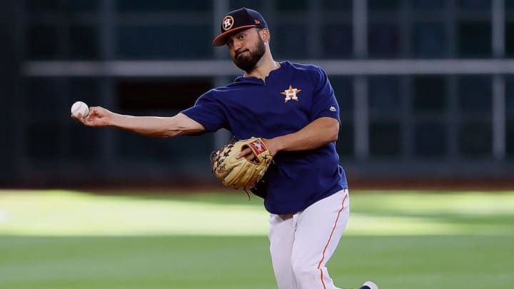 HOUSTON, TEXAS - MAY 28: Jack Mayfield #9 of the Houston Astros takes infield before playing against the Chicago Cubs at Minute Maid Park on May 28, 2019 in Houston, Texas. Mayfield made his Major League debut yesterday.  (Photo by Bob Levey/Getty Images)