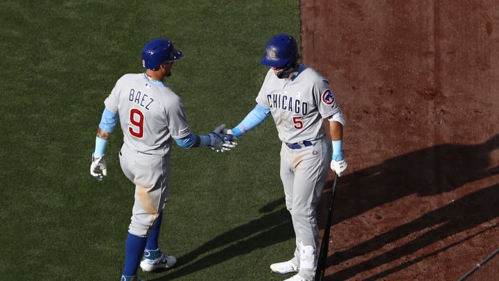 LOS ANGELES, CALIFORNIA - JUNE 16: Javier Baez #9 of the Chicago Cubs is congratulated by teammate Albert Almora Jr. #5 after Baez scored in the sixth inning of the MLB game against the Los Angeles Dodgers at Dodger Stadium on June 16, 2019 in Los Angeles, California. The Dodgers defeated the Cubs 3-2. (Photo by Victor Decolongon/Getty Images)
