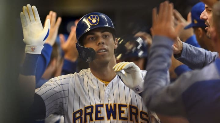 MILWAUKEE, WISCONSIN - SEPTEMBER 06:  Christian Yelich #22 of the Milwaukee Brewers is congratulated by teammates following a home run against the Chicago Cubs during a game at Miller Park on September 06, 2019 in Milwaukee, Wisconsin. (Photo by Stacy Revere/Getty Images)