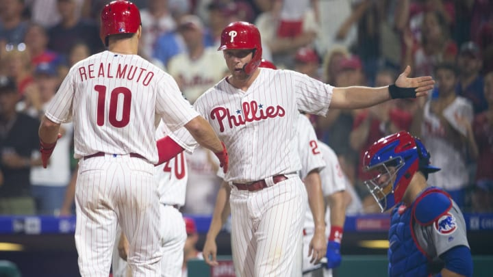PHILADELPHIA, PA - AUGUST 14: J.T. Realmuto #10 of the Philadelphia Phillies celebrates with Rhys Hoskins #17 after hitting a grand slam in the bottom of the third inning against the Chicago Cubs at Citizens Bank Park on August 14, 2019 in Philadelphia, Pennsylvania. The Phillies defeated the Cubs 11-1. (Photo by Mitchell Leff/Getty Images)