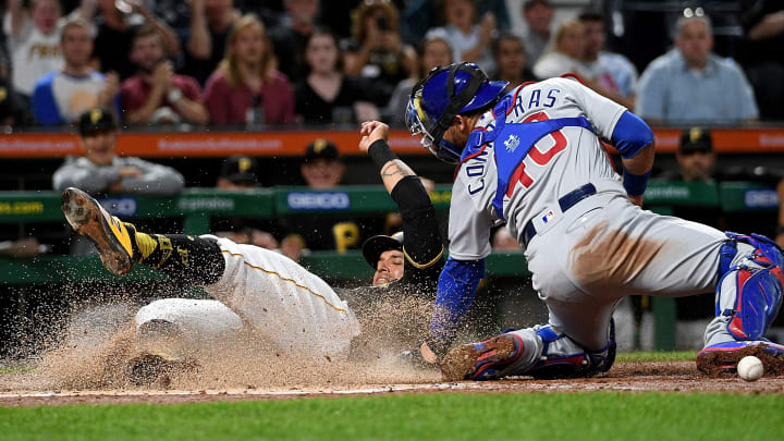 PITTSBURGH, PA - SEPTEMBER 25: Jose Osuna #36 of the Pittsburgh Pirates slides safely past Willson Contreras #40 of the Chicago Cubs to score after an RBI double by Erik Gonzalez #2 in the fourth inning during the game at PNC Park on September 25, 2019 in Pittsburgh, Pennsylvania. (Photo by Justin Berl/Getty Images)