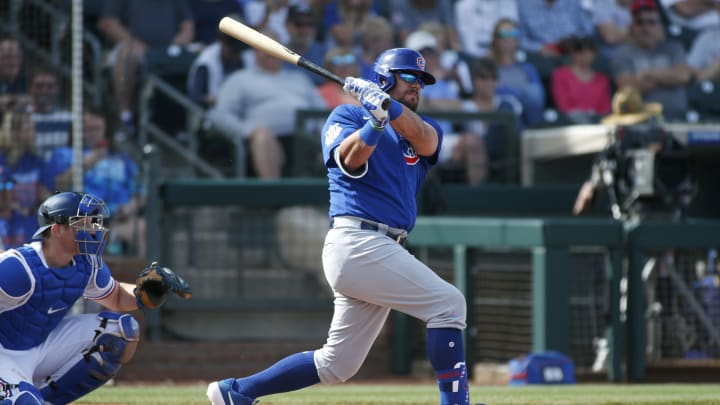 Kyle Schwarber hits for the Chicago Cubs against the Texas Rangers