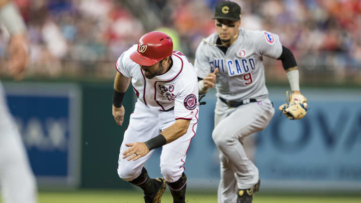 WASHINGTON, DC - MAY 18: Adam Eaton #2 of the Washington Nationals is chased by Javier Baez #9 of the Chicago Cubs before being caught stealing during the third inning at Nationals Park on May 18, 2019 in Washington, DC. (Photo by Scott Taetsch/Getty Images)