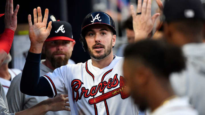ATLANTA, GEORGIA - AUGUST 31: Matt Joyce #14 of the Atlanta Braves celebrates in the dugout after scoring in the first inning against the Chicago White Sox at SunTrust Park on August 31, 2019 in Atlanta, Georgia. (Photo by Logan Riely/Getty Images)