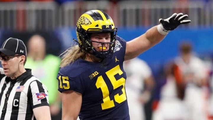 ATLANTA, GEORGIA - DECEMBER 29:  Chase Winovich #15 of the Michigan Wolverines celebrates a tackle in the third quarter against the Florida Gators during the Chick-fil-A Peach Bowl at Mercedes-Benz Stadium on December 29, 2018 in Atlanta, Georgia. (Photo by Joe Robbins/Getty Images)