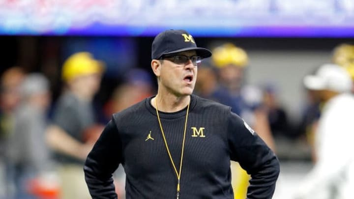 ATLANTA, GEORGIA - DECEMBER 29: Head coach Jim Harbaugh of the Michigan Wolverines looks on during warm ups prior to the Chick-fil-A Peach Bowl against the Florida Gators at Mercedes-Benz Stadium on December 29, 2018 in Atlanta, Georgia. (Photo by Joe Robbins/Getty Images)
