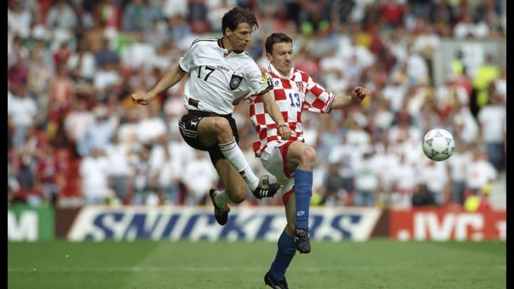 Christian Ziege (left) beats Mario Stanic of Croatia to the ball