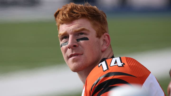 ORCHARD PARK, NY - OCTOBER 18: Andy Dalton #14 of the Cincinnati Bengals looks on from the bench against the Buffalo Bills during NFL game action at Ralph Wilson Stadium on October 18, 2015 in Orchard Park, New York. (Photo by Tom Szczerbowski/Getty Images)