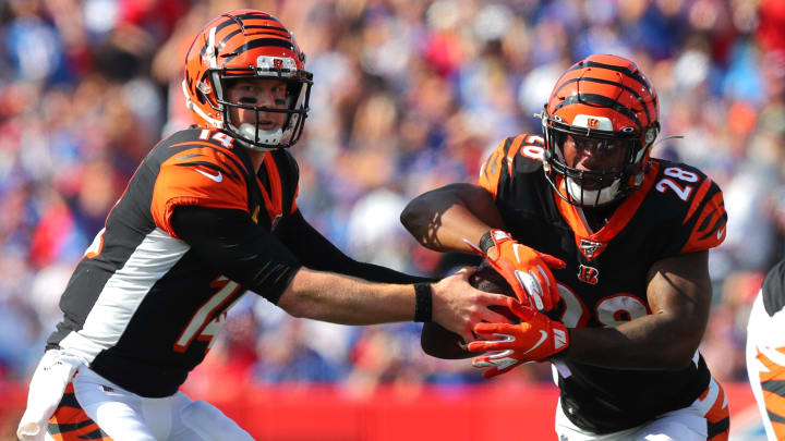 ORCHARD PARK, NY - SEPTEMBER 22:  Andy Dalton #14 of the Cincinnati Bengals hands the ball off to Joe Mixon #28 of the Cincinnati Bengals during the second half against the Buffalo Bills at New Era Field on September 22, 2019 in Orchard Park, New York. Buffalo beats Cincinnati 21 to 17.  (Photo by Timothy T. Ludwig/Getty Images)
