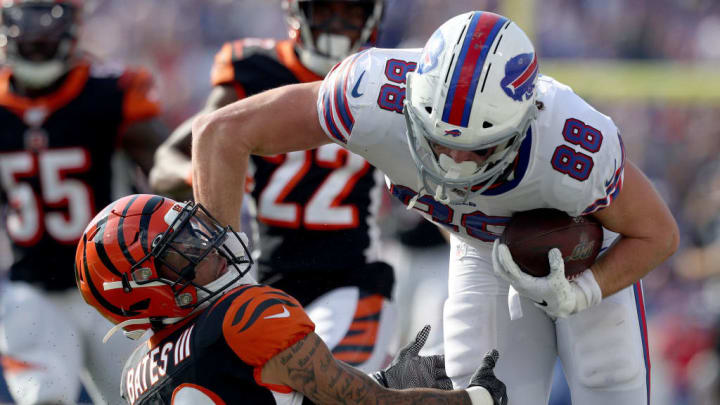 ORCHARD PARK, NEW YORK - SEPTEMBER 22: Jessie Bates #30 of the Cincinnati Bengals attempts to tackle Dawson Knox #88 of the Buffalo Bills during a game at New Era Field on September 22, 2019 in Orchard Park, New York. (Photo by Bryan M. Bennett/Getty Images)