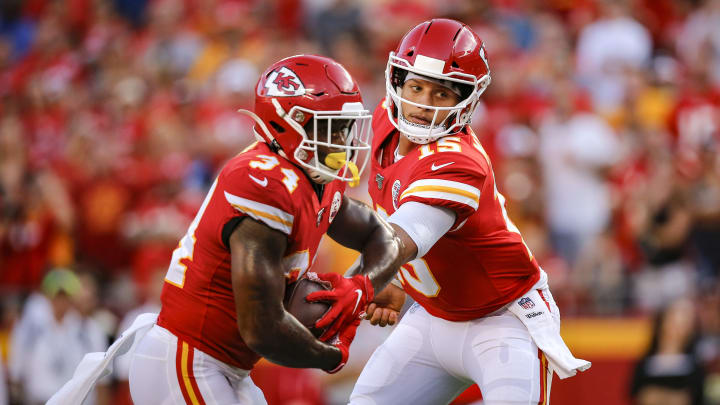KANSAS CITY, MO - AUGUST 10: Patrick Mahomes #15 of the Kansas City Chiefs hands the football off to Carlos Hyde #34 for a touchdown run against the Cincinnati Bengals in the first half during a preseason game at Arrowhead Stadium on August 10, 2019 in Kansas City, Missouri. (Photo by David Eulitt/Getty Images)