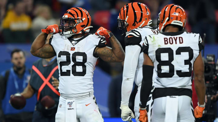 LONDON, ENGLAND - OCTOBER 27: Joe Mixon of Cincinnati Bengals celebrates scoring his sides first touch down with his teammates during the NFL game between Cincinnati Bengals and Los Angeles Rams at Wembley Stadium on October 27, 2019 in London, England. (Photo by Alex Davidson/Getty Images)