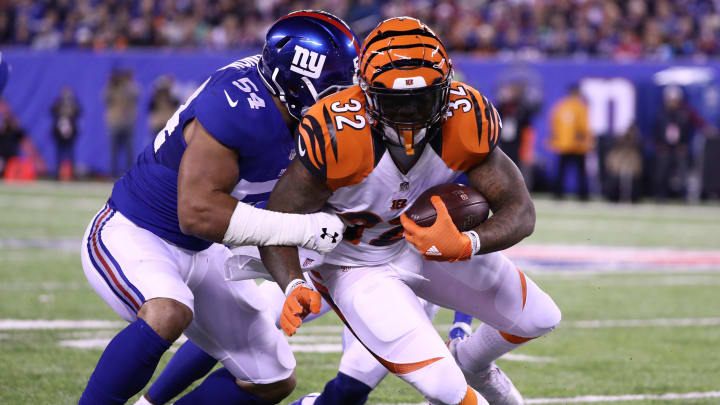 EAST RUTHERFORD, NJ - NOVEMBER 14:   Deontae Skinner #54 of the New York Giants tackles  Jeremy Hill #32 of the Cincinnati Bengals during their game at MetLife Stadium on November 14, 2016 in East Rutherford, New Jersey.  (Photo by Al Bello/Getty Images)