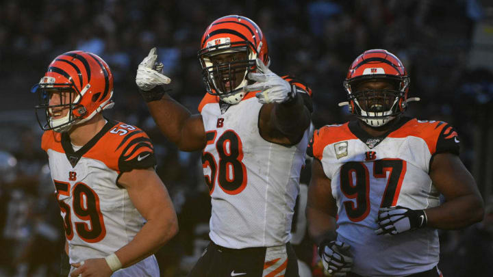 OAKLAND, CALIFORNIA - NOVEMBER 17: Carl Lawson #58 of the Cincinnati Bengals celebrates after a sack of Derek Carr #4 of the Oakland Raiders during their NFL game at RingCentral Coliseum on November 17, 2019 in Oakland, California. (Photo by Robert Reiners/Getty Images)