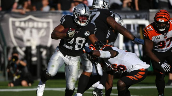 OAKLAND, CALIFORNIA - NOVEMBER 17: Josh Jacobs #28 of the Oakland Raiders rushes against the Cincinnati Bengals during their NFL game at RingCentral Coliseum on November 17, 2019 in Oakland, California. (Photo by Robert Reiners/Getty Images)