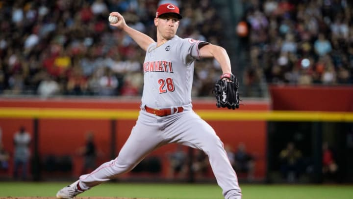PHOENIX, ARIZONA - SEPTEMBER 14: Anthony DeSclafani #28 of the Cincinnati Reds delivers a pitch in the first inning of the MLB game against the Arizona Diamondbacks at Chase Field on September 14, 2019 in Phoenix, Arizona. (Photo by Jennifer Stewart/Getty Images)