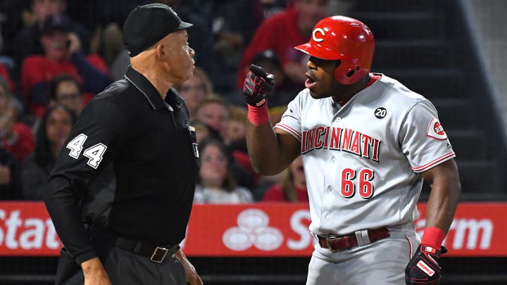 ANAHEIM, CA - JUNE 25: Yasiel Puig #66 of the Cincinnati Reds yells at home plate umpire Kerwin Danley #44 after he was thrown out of the game for arguing a third strike call in the sixth inning against the Los Angeles Angels at Angel Stadium of Anaheim on June 25, 2019 in Anaheim, California. (Photo by Jayne Kamin-Oncea/Getty Images)