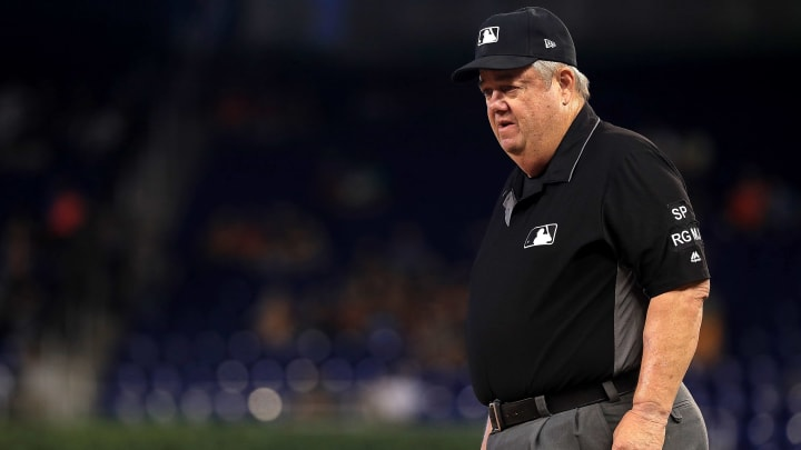 Joe West was under fire earlier this season when he confiscated the hat of Cardinals pitcher Giovanny Gallegos.
