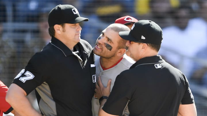 Joey Votto speaks with the umpire.
