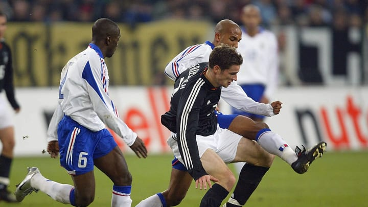 Claude Makelele and Oliver Dacourt battle with Arne Friedrich