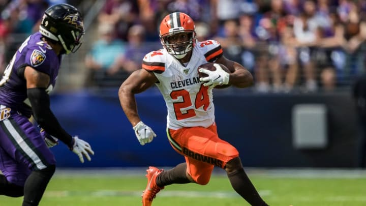 BALTIMORE, MD - SEPTEMBER 29: Nick Chubb #24 of the Cleveland Browns carries the ball against Earl Thomas #29 of the Baltimore Ravens during the first half at M&T Bank Stadium on September 29, 2019 in Baltimore, Maryland. (Photo by Scott Taetsch/Getty Images)