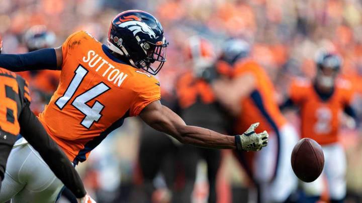 DENVER, CO - NOVEMBER 3:  Courtland Sutton #14 of the Denver Broncos misses a pass thrown behind him that hits him in the palm during a game against the Cleveland Browns at Broncos Stadium at Mile High on November 3, 2019 in Denver, Colorado.   (Photo by Wesley Hitt/Getty Images)