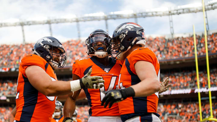 DENVER, CO - NOVEMBER 3:  Wide receiver Courtland Sutton #14 of the Denver Broncos celebrates his touchdown reception with (R) fullback Andy Janovich #32 and tight end Troy Fumagalli #84 during the first quarter against the Cleveland Browns at Broncos Stadium at Mile High on November 3, 2019 in Denver, Colorado. (Photo by Justin Edmonds/Getty Images)