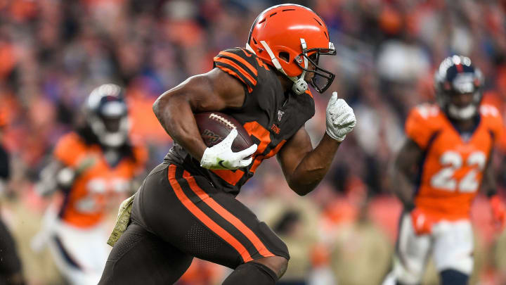 DENVER, CO - NOVEMBER 3:  Nick Chubb #24 of the Cleveland Browns carries the ball against the Denver Broncos in the third quarter of a game at Empower Field at Mile High on November 3, 2019 in Denver, Colorado.  (Photo by Dustin Bradford/Getty Images)