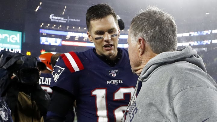 FOXBOROUGH, MASSACHUSETTS - OCTOBER 27: Tom Brady #12 of the New England Patriots congratulates head coach Bill Belichick on his 300th win after the game against the Cleveland Browns at Gillette Stadium on October 27, 2019 in Foxborough, Massachusetts. (Photo by Omar Rawlings/Getty Images)