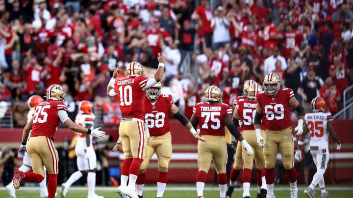 SANTA CLARA, CALIFORNIA - OCTOBER 07: Quarterback Jimmy Garoppolo #10 of the San Francisco 49ers celebrates the touchdown run by Matt Breida#22 in the first quarter against Cleveland Browns at Levi's Stadium on October 07, 2019 in Santa Clara, California. (Photo by Ezra Shaw/Getty Images)