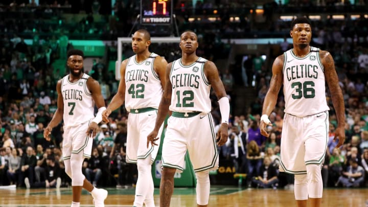 BOSTON, MA - MAY 13: Jaylen Brown #7, Al Horford #42, Terry Rozier #12 and Marcus Smart #36 of the Boston Celtics walk back on the court after a timeout against the Cleveland Cavaliers during the second quarter in Game One of the Eastern Conference Finals of the 2018 NBA Playoffs at TD Garden on May 13, 2018 in Boston, Massachusetts.  (Photo by Maddie Meyer/Getty Images)