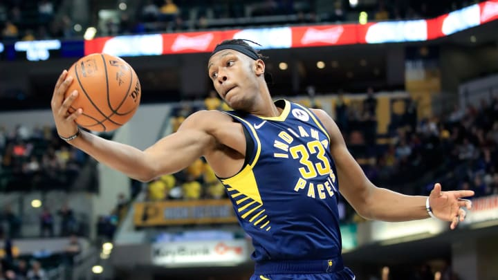 INDIANAPOLIS, IN - DECEMBER 18:  Myles Turner #33 of the Indiana Pacers grabs a rebound against the Cleveland Cavaliers  at Bankers Life Fieldhouse on December 18, 2018 in Indianapolis, Indiana.  NOTE TO USER: User expressly acknowledges and agrees that, by downloading and or using this photograph, User is consenting to the terms and conditions of the Getty Images License Agreement.  (Photo by Andy Lyons/Getty Images)