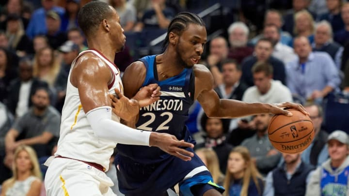 MINNEAPOLIS, MN - OCTOBER 19: Andrew Wiggins #22 of the Minnesota Timberwolves drives to the basket against Rodney Hood #1 of the Cleveland Cavaliers on October 19, 2018 at the Target Center in Minneapolis, Minnesota. The Timberwolves defeated the Cavaliers 131-123. NOTE TO USER: User expressly acknowledges and agrees that, by downloading and or using this Photograph, user is consenting to the terms and conditions of the Getty Images License Agreement. (Photo by Hannah Foslien/Getty Images)