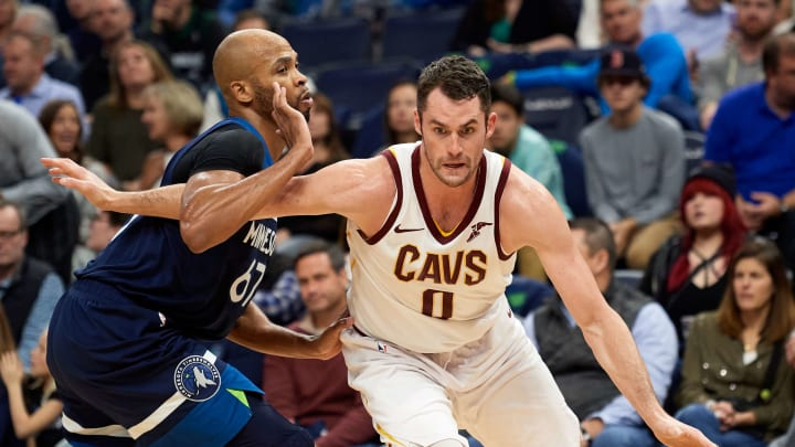MINNEAPOLIS, MN - OCTOBER 19: Kevin Love #0 of the Cleveland Cavaliers drives to the basket against Taj Gibson #67 of the Minnesota Timberwolves during the game on October 19, 2018 at the Target Center in Minneapolis, Minnesota. The Timberwolves defeated the Cavaliers 131-123. NOTE TO USER: User expressly acknowledges and agrees that, by downloading and or using this Photograph, user is consenting to the terms and conditions of the Getty Images License Agreement. (Photo by Hannah Foslien/Getty Images)