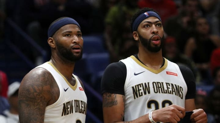 NEW ORLEANS, LA - OCTOBER 28:  DeMarcus Cousins #0 and Anthony Davis #23 of the New Orleans Pelicans stand on the bench at the Smoothie King Center on October 28, 2017 in New Orleans, Louisiana.  NOTE TO USER: User expressly acknowledges and agrees that, by downloading and or using this photograph, User is consenting to the terms and conditions of the Getty Images License Agreement.  (Photo by Chris Graythen/Getty Images)