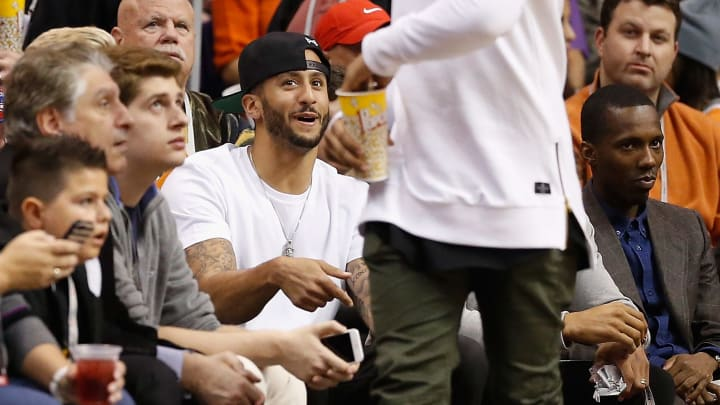 PHOENIX, AZ - JANUARY 13:  San Francisco 49ers quarterback Colin Kaepernick talks with New York Giants wide receiver Odell Beckham Jr. as they attend the NBA game between the Phoenix Suns and the Cleveland Cavaliers at US Airways Center on January 13, 2015 in Phoenix, Arizona. The Suns defeated the Cavaliers 107-100.  NOTE TO USER: User expressly acknowledges and agrees that, by downloading and or using this photograph, User is consenting to the terms and conditions of the Getty Images License Agreement.  (Photo by Christian Petersen/Getty Images)