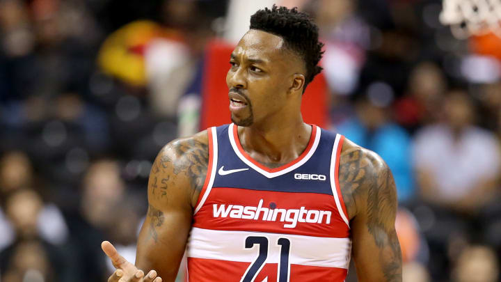 WASHINGTON, DC - NOVEMBER 14: Dwight Howard #21 of the Washington Wizards reacts after a play against the Cleveland Cavaliers during the first half at Capital One Arena on November 14, 2018 in Washington, DC. NOTE TO USER: User expressly acknowledges and agrees that, by downloading and or using this photograph, User is consenting to the terms and conditions of the Getty Images License Agreement. (Photo by Will Newton/Getty Images)