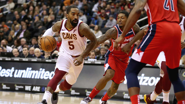 WASHINGTON, DC - NOVEMBER 14: JR Smith #5 of the Cleveland Cavaliers dribbles past Bradley Beal #3 of the Washington Wizards during the first half at Capital One Arena on November 14, 2018 in Washington, DC. NOTE TO USER: User expressly acknowledges and agrees that, by downloading and or using this photograph, User is consenting to the terms and conditions of the Getty Images License Agreement. (Photo by Will Newton/Getty Images)