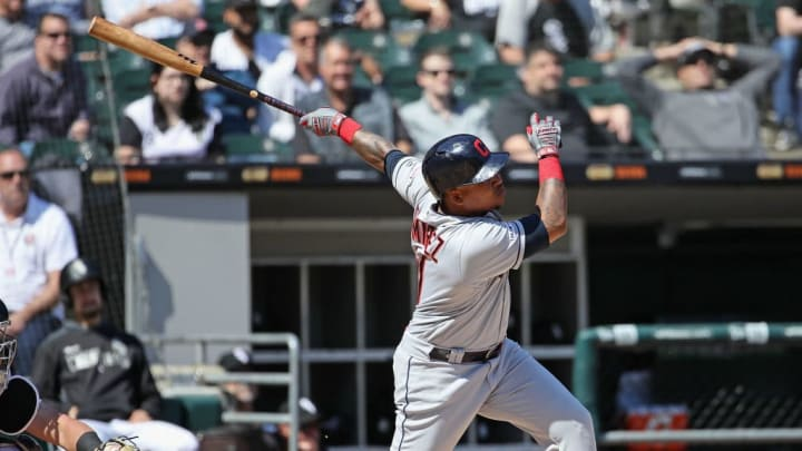 CHICAGO, ILLINOIS - MAY 14: Jose Ramirez #11 of the Cleveland Indians hits a solo home run in the 6th inning against the Chicago White Sox at Guaranteed Rate Field on May 14, 2019 in Chicago, Illinois. (Photo by Jonathan Daniel/Getty Images)