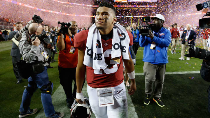 SANTA CLARA, CA - JANUARY 07:  Tua Tagovailoa #13 of the Alabama Crimson Tide walks off the field after his teams 44-16 loss to the Clemson Tigers in the CFP National Championship presented by AT&T at Levi's Stadium on January 7, 2019 in Santa Clara, California.  (Photo by Sean M. Haffey/Getty Images)