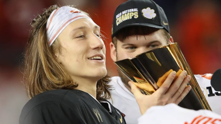 SANTA CLARA, CA - JANUARY 07:  Trevor Lawrence #16 of the Clemson Tigers celebrates with the trophy after his teams 44-16 win over the Alabama Crimson Tide in the CFP National Championship presented by AT&T at Levi's Stadium on January 7, 2019 in Santa Clara, California.  (Photo by Sean M. Haffey/Getty Images)