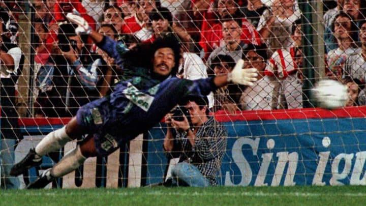 Colombian goalie Rene Higita dives attempting to s