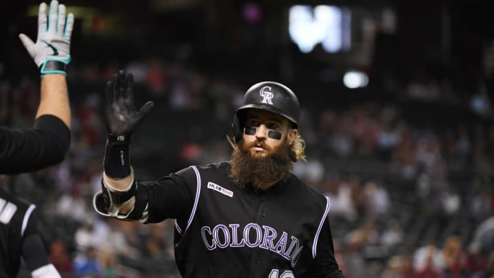 PHOENIX, ARIZONA - JUNE 20: Charlie Blackmon #19 of the Colorado Rockies celebrates with teammates after hitting a solo home run off of Robbie Ray of the Arizona Diamondbacks in the first inning at Chase Field on June 20, 2019 in Phoenix, Arizona. (Photo by Norm Hall/Getty Images)