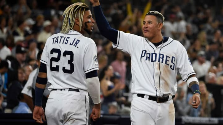 SAN DIEGO, CA - AUGUST 10: Manny Machado #13 of the San Diego Padres and Fernando Tatis Jr. #23 celebrate during a baseball game against the Colorado Rockies at Petco Park August 10, 2019 in San Diego, California.  (Photo by Denis Poroy/Getty Images)