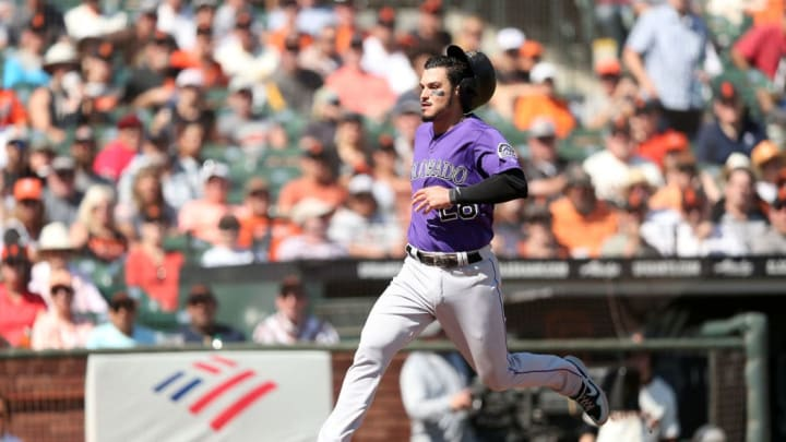 SAN FRANCISCO, CALIFORNIA - SEPTEMBER 26:  Nolan Arenado #28 of the Colorado Rockies runs home to score in the fourth inning against the San Francisco Giants at Oracle Park on September 26, 2019 in San Francisco, California. (Photo by Ezra Shaw/Getty Images)