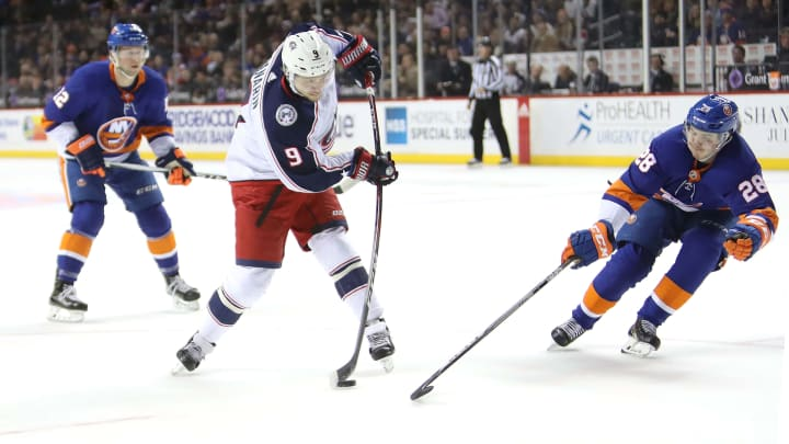 NEW YORK, NY - FEBRUARY 13: Artemi Panarin #9 of the Columbus Blue Jackets takes a shot against Sebastian Aho #28 of the New York Islanders in the first period during their game at Barclays Center on February 13, 2018 in the Brooklyn borough of New York City.  (Photo by Abbie Parr/Getty Images)